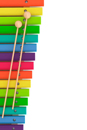 tuned: Colorful wooden xylophone with mallets on a white background