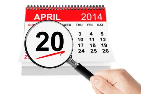 Orthodox Easter Concept. 20 april 2014 calendar with magnifier on a white background photo