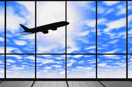 Aviation Concept. Airport windows with flying airplane