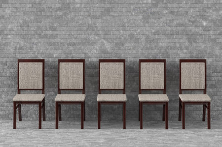Modern wood chairs in front of brick wall photo