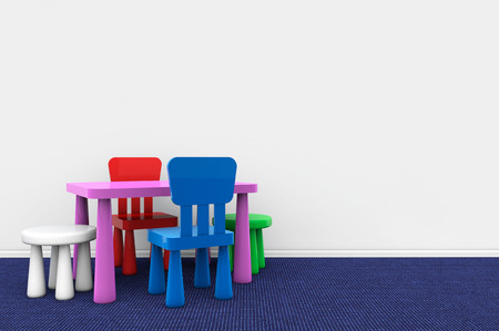 Kids desk and chairs against a blank wall