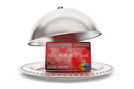 Silver Restaurant cloche with credit card on a white background photo