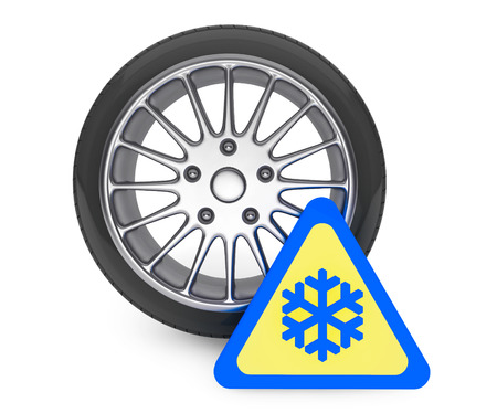 Winter Car Wheel Tire with snowflake sign on a white background photo