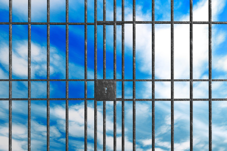 jailhouse: Metal Jail bars on a sky background Stock Photo