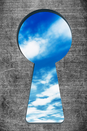 latency: Blue sky seen through the keyhole on a stone background