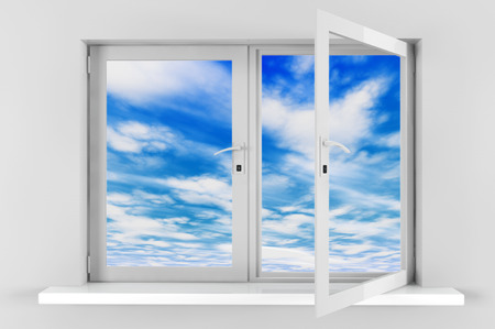 Blue sky with clouds seen through opened plastic window with gray wall photo