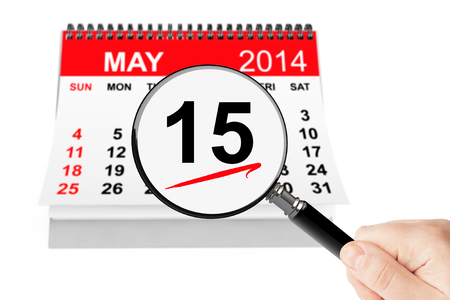 Tax Day Concept. 15 may 2014 calendar with magnifier on a white background photo