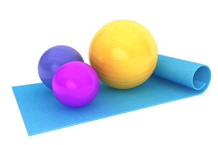 Exercise mat with colorful fitness balls on a white background
