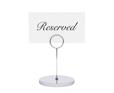 card holder: Note paper card holder with reserved sign on a white backround Stock Photo