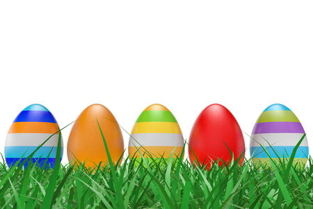 Easter eggs on green grass on a white background photo