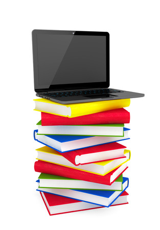 E-learning concept. Laptop on top of stack of colorful books on a white background photo