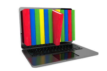 E-learning concept. Laptop with colorful books on a white background photo