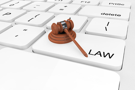 computer law: Law concept. Extreme closeup Judge Gavel on a keyboard Stock Photo