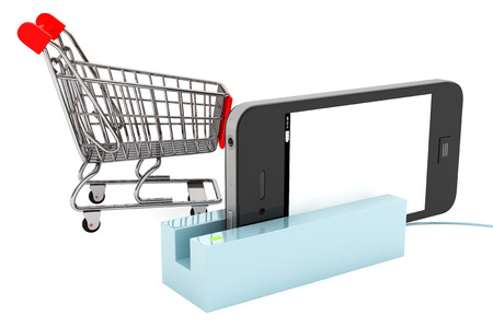 Shopping Cart with Modern Mobile phone in Card Reader on a white background photo