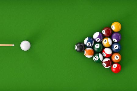 billiards cue: Glossy billiard balls set on a green billiards table
