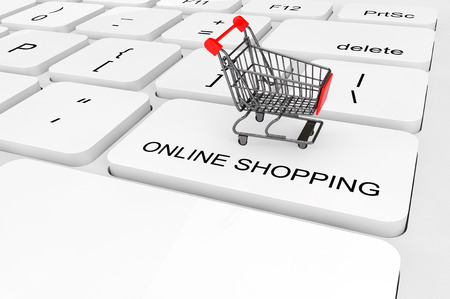 オンライン ショッピングの概念。極端なクローズ アップのキーボードでショッピング カート 写真素材 - 27002312