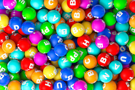 Abstract Background. Heap of closeup color Vitamins sphere photo