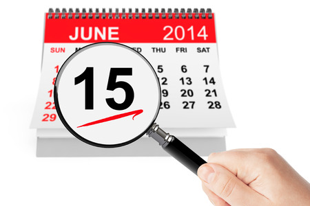 Fathers Day Concept. 15 june 2014 calendar with magnifier on a white background photo
