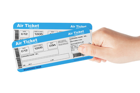 Fly air tickets holded by hand on a white background 版權商用圖片