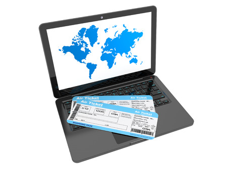 Online booking concept. Laptop with air tickets on a white background photo