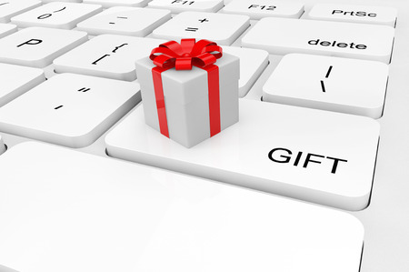 Gift concept. Extreme closeup gift box on a keyboard photo