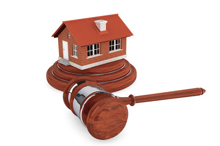 Justice Gavel with Brick House on a white background photo