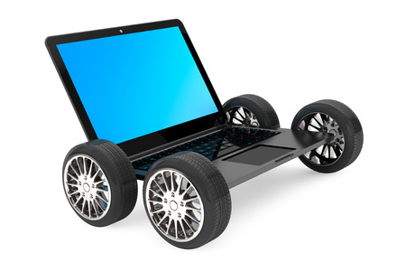 powerbook: Modern laptop with car wheels on a white background Stock Photo