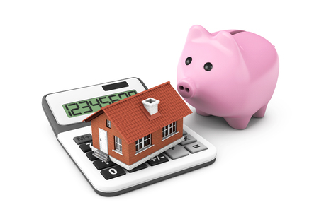 Real Estate Concept. House with calculator and Piggy Bank on a white background photo