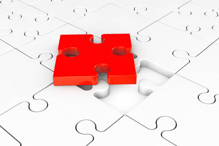 Idea Business Concept.  One red puzzle over group of white puzzles Stock Photo