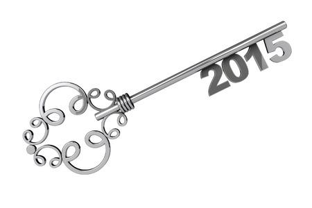 Vintage nyckel med 2015 års skylt på en vit bakgrund
