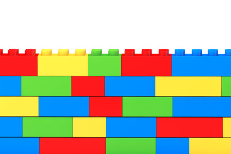 Wall from children plastic blocks on a white background photo