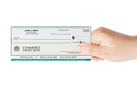 midsection: Banking Check holded by hand on a white background
