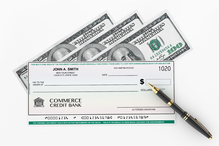 Blank Banking Check and Fountain Pen with Dollars Bills on a white background