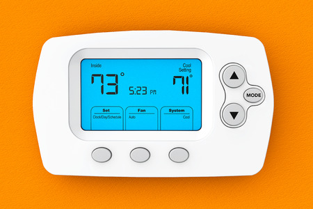 Modern Programming Thermostat on a orange wall Archivio Fotografico