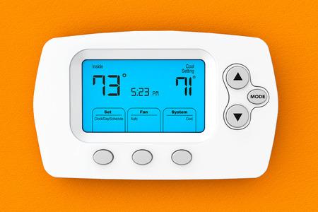 Modern Programming Thermostat on a orange wall Standard-Bild