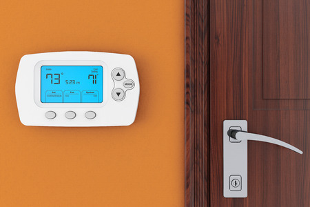 cold air: Modern Programming Thermostat on a wall near door