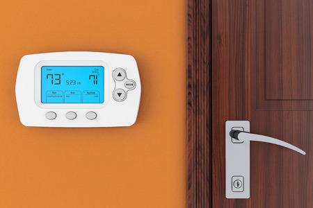 Moderne Programmeren Thermostaat op een muur in de buurt van de deur