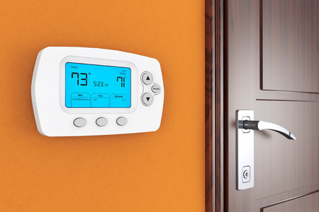 digital thermometer: Modern Programming Thermostat on a wall near door
