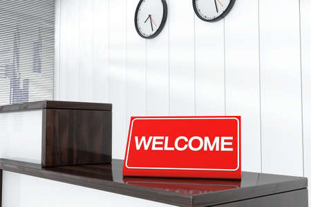 sign plate: Welcome Sign Plate on Wooden Reception Desk Stock Photo