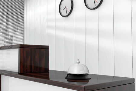 Service Bell over Wooden Reception Desk photo