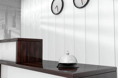 service desk: Service Bell over Wooden Reception Desk