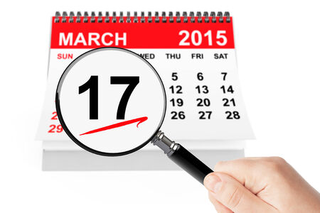 17 of march: St. Patrick Day Concept. 17 march 2015 calendar with magnifier on a white background Stock Photo