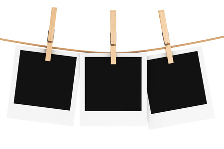 Photo Frame with Clothespin on a white background Stock Photo