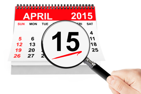 Tax Day Concept. 15 april 2015 calendar with magnifier on a white background photo
