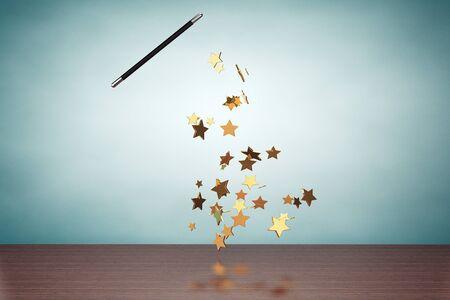abracadabra: Old Style Photo. Magic wand casting shiny golden stars on the table