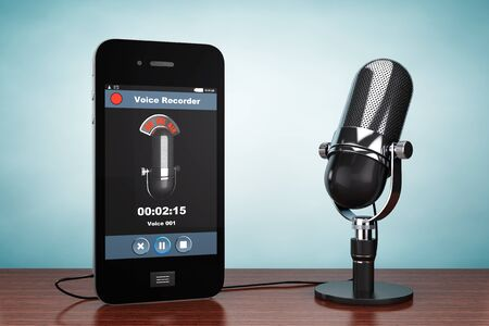 voice recorder: Old Style Photo. Mobile Phone as Voice Recorder with Microphone on the table
