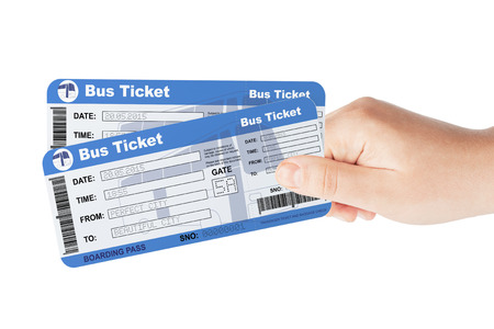 passenger buses: Los billetes de autobús retenidas por la mano sobre un fondo blanco Foto de archivo