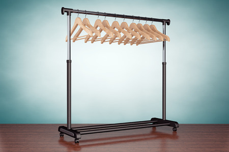 coat rack: Old Style Photo. Mobile black coat rack with hangers on the table Stock Photo