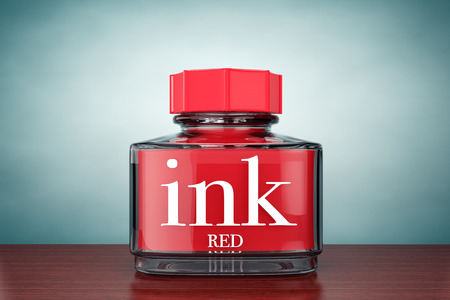 ink bottle: Old Style Photo. Red Ink Bottle on the table