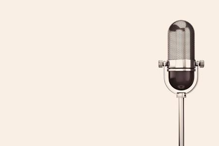 Vintage silver microphone on a white background Foto de archivo